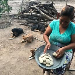 Mrs. Cruz-Alvarez making corn tortillas for dinner at her home in Guirocoba, Sonora.
